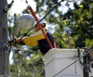 Grattan Line Construction employee working on a power outage in Worcester